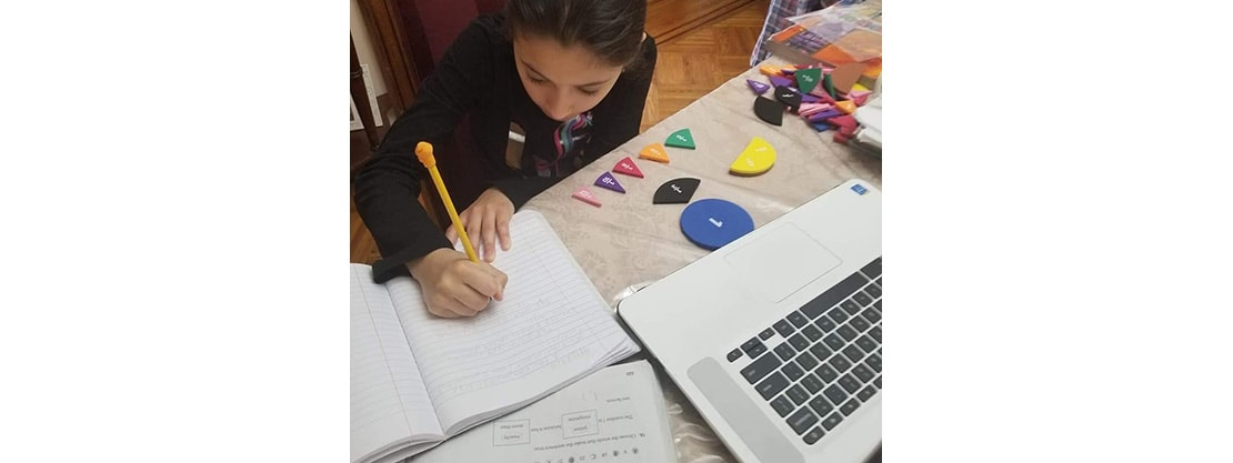 student working on distance learning with laptop