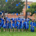 2021 graduates in caps and gowns